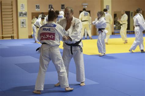 Vladimir Putin: Russian president grapples with judo coach