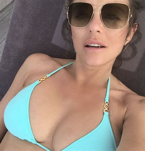 Liz Hurley swimwear: Actress flashes cleavage in sexy